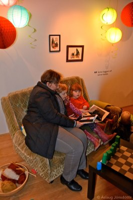 Reading in Little Monsters sofa